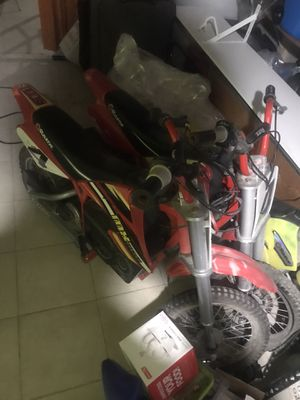 2 red motor bikes for Sale in Lawrence, MA