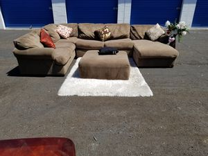 nice very big sofa Tan Sectional Sofa with Ottoman delivery free for Sale in Las Vegas, NV