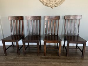 FOUR SOLID DARK WOOD DINING CHAIRS for Sale in Menifee, CA
