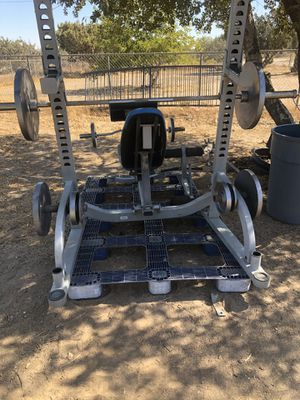 Olympic bench press squat rack incline declined military shoulder leg and preacher attachments curling bar and barbell 45s to 2.5s Olympic weights for Sale in Oak Hills, CA
