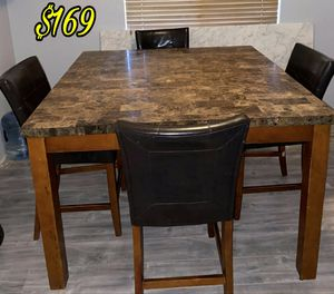 Good Condition Dining Table With Marble top Heavy Marble top Square Shape Fits 8 people Comes with 6 chairs only. Asking $169 for Sale in Santa Clarita, CA
