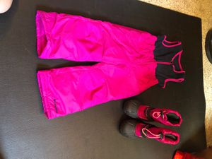 Girls 4T pink Columbia snow bib and Sorel size 10 boots for Sale in Portland, OR