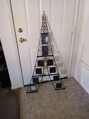 Eiffel Tower wall frame. Holds up to ten pictures.measure at 52' tall, It's in great conditions. $35. OBO for Sale in Palmdale, CA