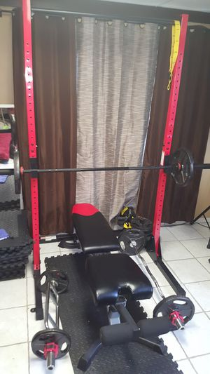 Bowflex weight bench, tower, Olympic bars and weights. for Sale in Gibsonton, FL