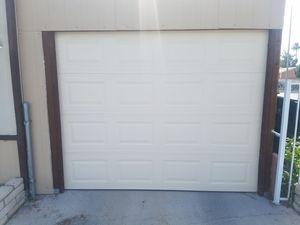 9ft wide 7ft tall garage door and opener for Sale in Las Vegas, NV