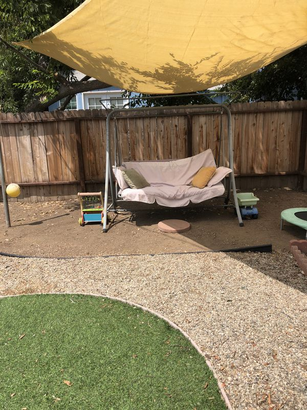 Porch swing -could use a new canopy and cushion