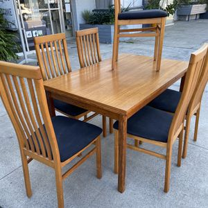 Beautiful danish teak dining table folds out With Six Chairs for Sale in San Diego, CA