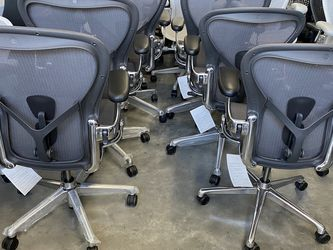 BRAND NEW POLISHED ALUMINUM REMASTERED AERON CHAIRS FULLY LOADED LEATHER ARM PADS POSTURE FIT SL FROM $975 SIZE A,B,C for Sale in Lynwood,  CA