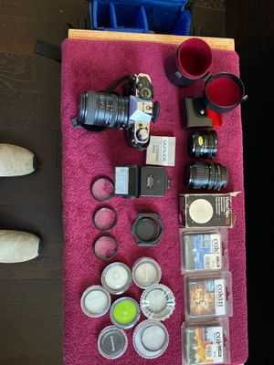 Canon AE-1 program with additional lenses filters Flashes and carrying case for Sale in East Northport, NY