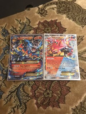 Pokemon Black mega Charizard, and volcanion ex for Sale in Springfield, PA