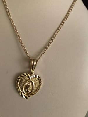 READ THE POST BEFORE THE MEDIUM MEDAL OF THE VIRGIN OF GUADALUPE WITH A CHAIN PLATED IN GOLD PLATED BRASIL14 K GUARANTEED $$ 25 PICK UP ONLY PLEASE for Sale in Riverside, CA