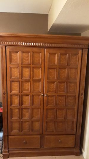 Armoire solid oak with 3 big shelves 2 smaller shelves and 2 drawers for Sale in Phoenix, AZ
