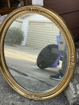 Gold oval wall mirror for Sale in Worth, IL