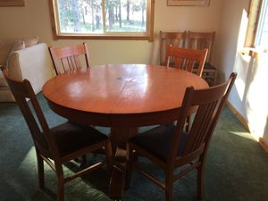 Solid Oak Pedestal table and chairs for Sale in Bend, OR