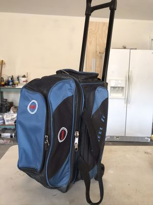 Two bowling balls in a double rolling bag for Sale in Corona, CA