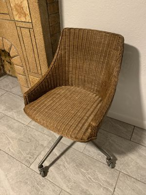 World Market wicker and metal rolling office chair for Sale in Denver, CO