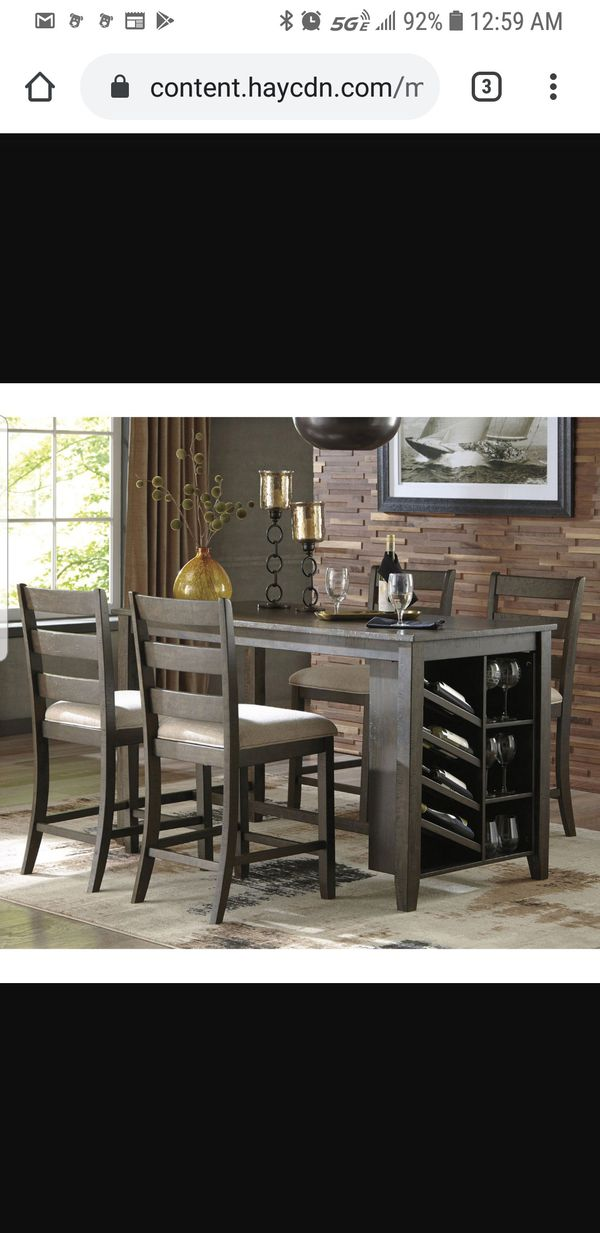Rokane dining room set from Ashley's Furniture- will send pictures if interested