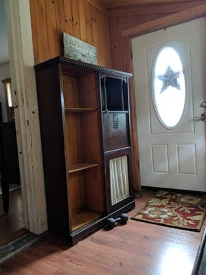 Antique secretary cabinet small mirror on upper right side then a key opens the small desk that folds out Needs some love beautiful detailing for Sale in Bellport, NY