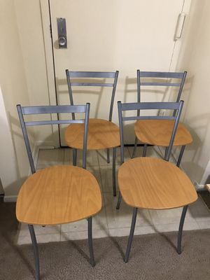 Still available 4 dining or kitchen chairs only no table wood with gray metal frame pick up Gaithersburg md20877 for Sale in Gaithersburg, MD