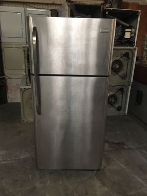 Refrigerator brand Frigidaire everything is good working condition 90 days warranty delivery and installation for Sale in San Leandro, CA