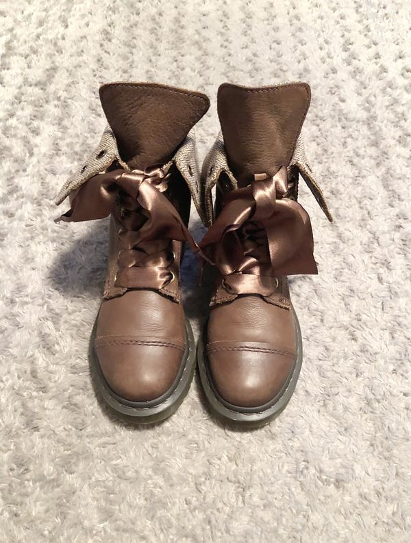 "Women's Dr. Martens boots paid $175 size 7 great condition. The style ""Aimilita"" Combat Boot color Dark Brown only worn once. Can be worn folded down"