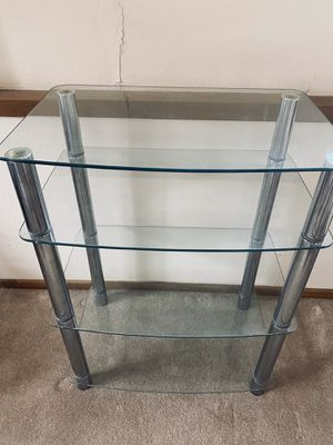 Glass shelf / tv stand for Sale in Colorado Springs, CO