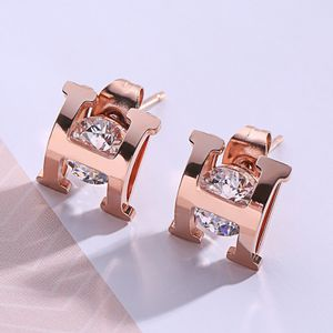 Fashion Letter H design Titanium Rose Gold Surrounded by diamonds Stud Earrings for Sale in Corona, CA