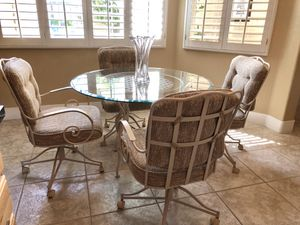 Kitchen dining table with chairs and glass top for Sale in Las Vegas, NV