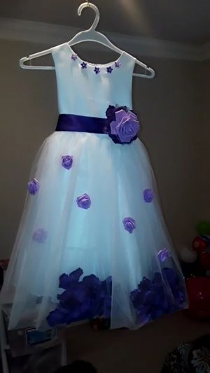 Wedding dress 4 years new with flowers head purple and lavender colors for Sale in Houston, TX