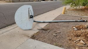 Just pulled up an In ground basketball pole, backboard and hoop. No longer need. for Sale in Phoenix, AZ