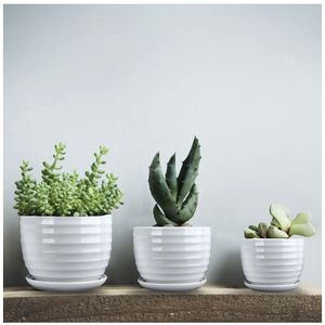 nchRound Modern Ceramic Garden Flower Pots Small to Medium Sized for Sale in Los Angeles, CA