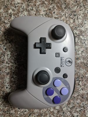 Fake Nintendo switch pro controller with SNES case for Sale in Riverside, CA