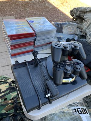 PS3/ 2 controllers/Charging Stand/20 Games for Sale in North Las Vegas, NV