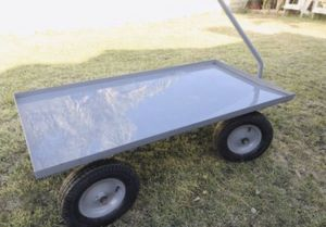 Metal wagon cart - heavy duty Used all wheels get stuck needs some repair on that ... Like new never used -FROM ULINE METAL BIG WAGON CART for Sale in Bloomington, CA