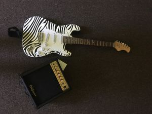 California electric guitar with base and guitar cover and wire for Sale in New Haven, CT
