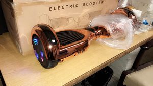 Rose gold Bluetooth hover boards hoverboard for Sale in Chicago, IL