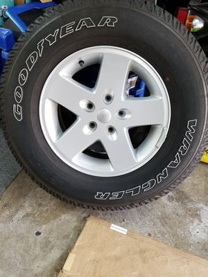 Mint condition, 5 wheels and tires for jeep 5x5 bolt pattern for Sale in Glen Ellyn, IL