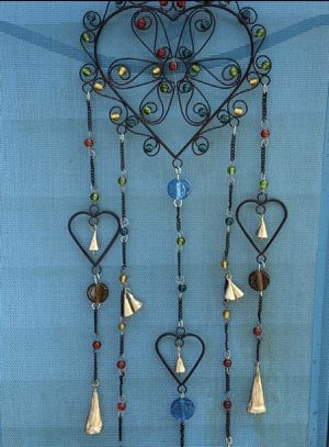 Wrought Iron Hearts & Flower Wind Chime Sun Catcher Mobile With Glass Beads for Sale in Nashville, TN
