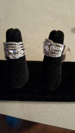 Rings.....Size 7...Diamonique 4 piece 10 karat white gold filled wedding set for Sale in St. Louis,  MO