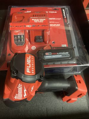 Milwaukee 1400lb m18 fuel 1/2 impact with batter and charger for Sale in Phoenix, AZ