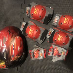 McQueen Bike Helmet and protective pads and gloves for Sale in Redmond, WA