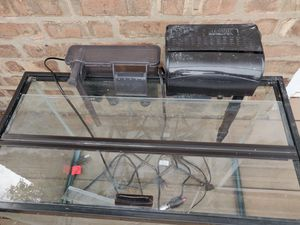 20 gallon aquarium fish tank with glass top and free filters and heater and for Sale in Chicago, IL