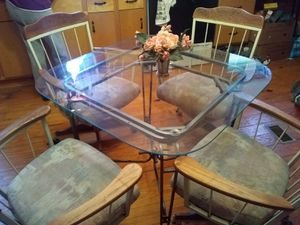 Glass table with 4 rolling chairs. Table is in great condition chairs to use touch up paint job. Can be used in kitchen or outside on a deck. for Sale in Snow Camp, NC