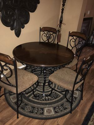 Beautiful & Elegant ASHLEY dining table with 4 chairs, very sturdy & clean. for Sale in Fort Worth, TX