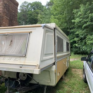 Apache hard sided camper 13 feet closed and 24 feet open needs cleaning and recover cushions for Sale in Mount Airy, NC