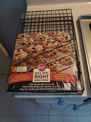 Cookie pans and three tier cookie cooking rack. Made by Wilton BRAND NEW for Sale in Atlanta, GA