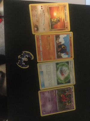 4 Pokemon cards and a pin for 7 dallors. for Sale in Monaca, PA