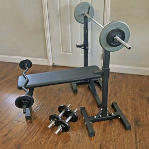 Brand New) Compact Home Gym, Flat Bench, Squat Rack, Standard Weights, Dumbbells, Curl Bar for Sale in San Jose, CA