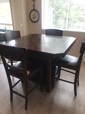 5 pc dining table with lazy susan and wine rack for Sale in Laguna Beach, CA