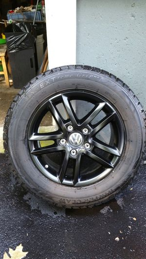 Volkswagen 17 rim and snow tires for Sale in Maynard, MA